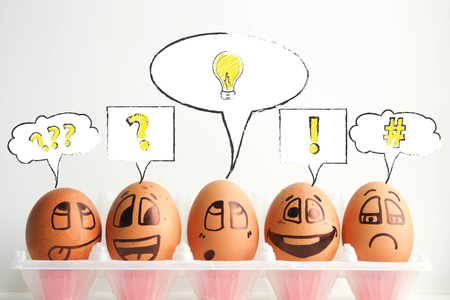 Concept idea, discovery, innovation. Photo - illustration for design. Eggs with painted face. Horizontal orientation of the sheet.
