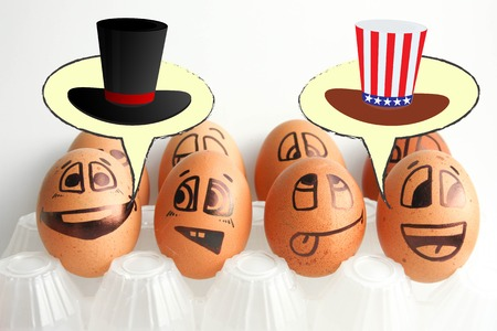 US Independence Day. Cylinder is a presidents hat with the color of the flag and the hatchery cylinder. Photo - illustration for design. Eggs with painted face. Horizontal orientation of the sheet.