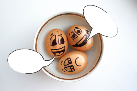 Eggs with painted face. Photo for your design. Eggs float in a plate. three eggs. Clouds and thoughts. Place for text