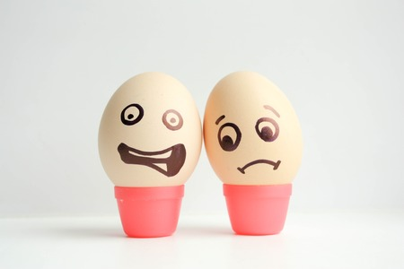 Eggs with painted face. Concept of failure