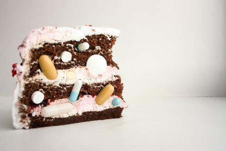 Medical cake from medicinal multi-colored tablets. Handful on a white background. Photo for your design Stock Photo