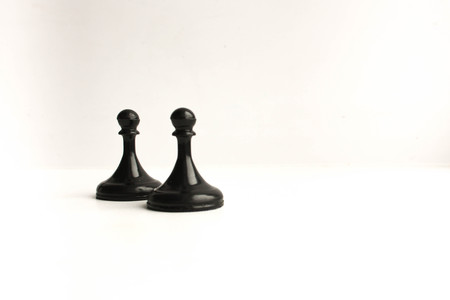 chessmen. Concept of business game. Pawn and pawn on white background. Photo for your design Stock Photo