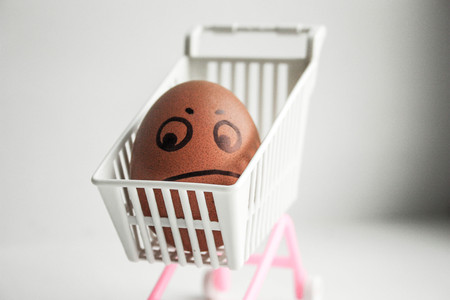 Shopping on the internet concept. Funny egg with a painted face. Photo for your design