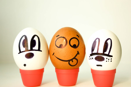 African American teaser, instigator, first concept. Eggs with painted face. black and white. on a white background. Photo for your design Stock Photo