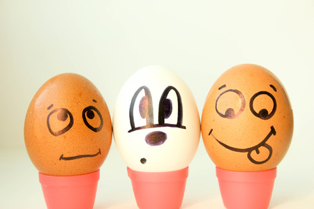 Nationality concept. Eggs with painted face. black and white. on a white background. Photo for your design