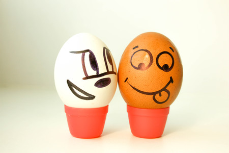 interracial: Interracial love concept. Eggs with painted face. black and white. on a white background. Photo for your design Stock Photo