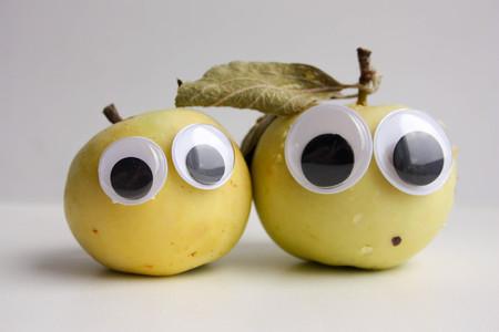 protruding eyes: Apple green for children. Natural. Apple two with protruding eyes. Photo for your design