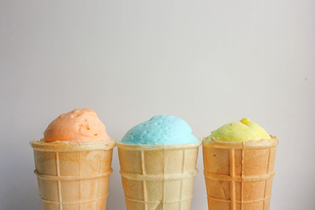 Ice cream in a cup of waffle light. Top view in a row. Close-up shooting. gentle colors. Photo for your design.