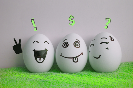 Concept of the idea of earning. Startup. Eggs are cheerful with a face. Two pieces. Concept of relaxing on the grass. Photo for your design