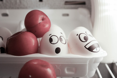 Concept of enlightening ideas. Eggs in the refrigerator near the lamp with a plum. Collective insight. Collective intellectual work. Photo for your design. Stock Photo