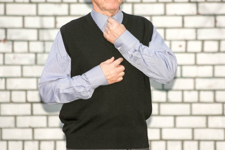 Business concept. The man fastens the button around his neck. Photo for your design Stock Photo