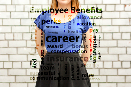 employee benefits concept. photo for your design. girl in blue near a white brick wall