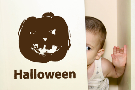 Halloween. the boy is hiding in the closet. pumpkin dark ominous Stock Photo