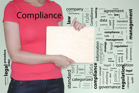 compliance concept. girl in red holds a wooden plaque in her hands in profile