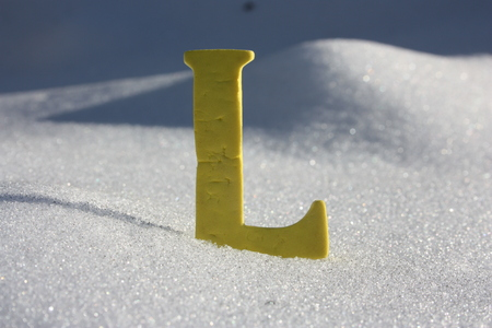 l letter on a background of a snow hill. photo for your design