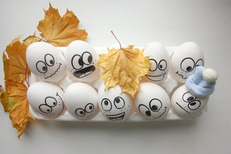 concept autumn. funny eggs in the autumn leaves. horizontal sheet orientation