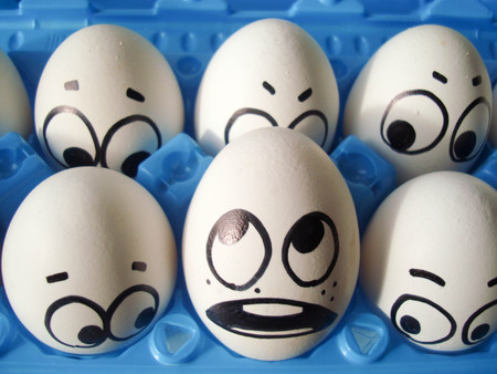 crisis psychology concept. photo for your design. funny eggs in a box