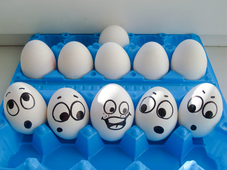 team and communication concept. comically. photo with face painted on eggs