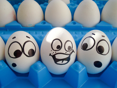 henpecked comedic. photo with face painted on eggs Zdjęcie Seryjne