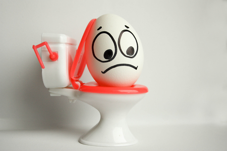 hemorrhoids concept. funny egg on the toilet. photo for your design