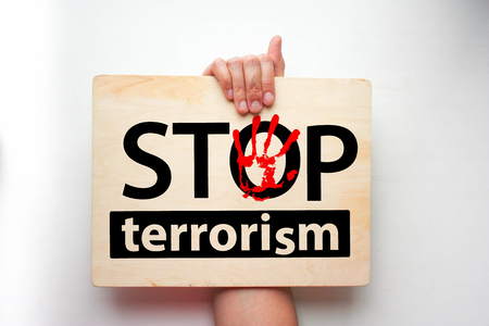 stop terrorism concept. the inscription on the wooden plaque is horizontal
