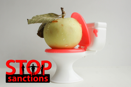 STOP SANCTIONS CONCEPT. letters and silhouettes of people. The apple is on the toilet. humor and sarcasm