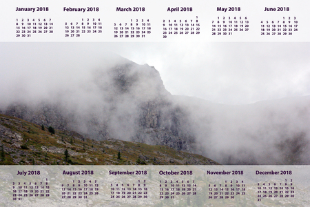 New Year's calendar 2018. mountain highly above the ground. white fog dense. a beautiful landscape for the press, design, t-shirts, undershirts, cards. photo.