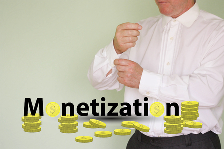 monetization concept. income from a hobby. business man and coin text Stock Photo