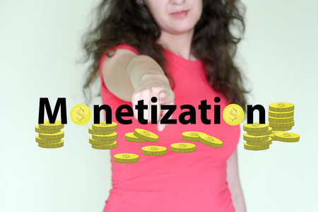 monetization concept. income from a hobby. young woman and text with coins. press the button with your index finger
