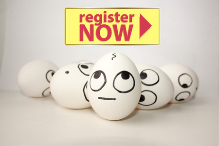 register now concept. funny eggs. look up at the inscription Stock Photo