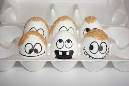baldness problem concept. the eggs are funny and cute. photo with painted face on the shell. satire and comedic. Stock Photo