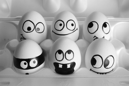 surprise concept. the eggs are funny and cute. photo with painted face on the shell. satire and comedy. eggv Stock Photo
