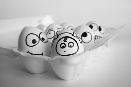 maternity hospital concept. a new member of the family. the eggs are funny and cute. photo with painted face on the shell. satire and comedy. egg Stock Photo