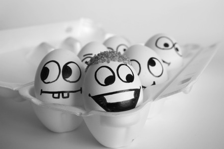 treatment of baldness concept. the eggs are funny and cute. photo with painted face on the shell. satire and comedy. egg Stock Photo