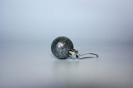 Christmas tree. decoration for spruce. silver ball in sequins. photo for your design. Stock Photo
