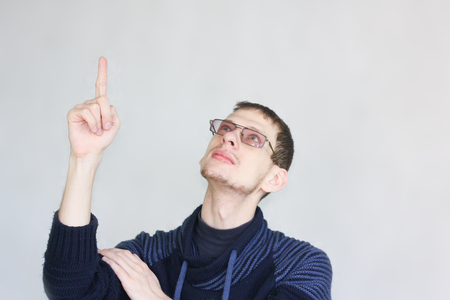 direction concept. male attractive with glasses student showing thumb up. portrait on white 写真素材