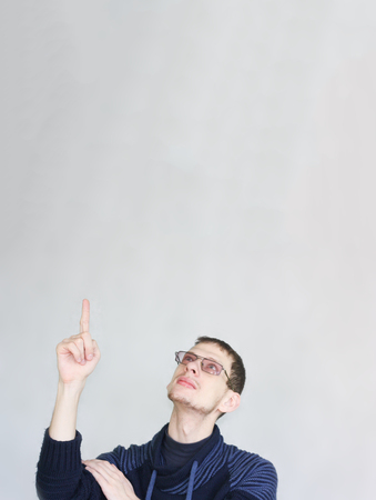 direction concept. male attractive with glasses student showing thumb up. portrait on white with place for text