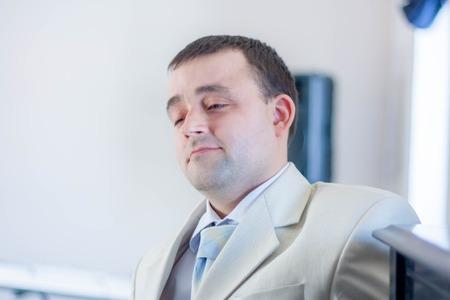the man pondered. white tuxedo. historical dances Фото со стока