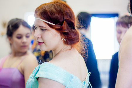 aristocrat. Beautiful redhead girl. portrait in profile among people. historical dance. cosplay