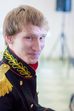 a man in black military uniform. portrait. vertical sheet orientation