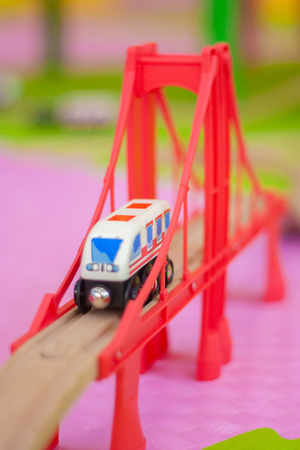 train on a toy bridge. childrens games for boys. vertical sheet orientation Stock Photo