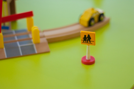 a pedestrian crossing sign for children. training in traffic rules. moving car on a bridge Stock Photo