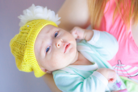 baby. proper nutrition of the child. girl in a hat with a bow Banco de Imagens
