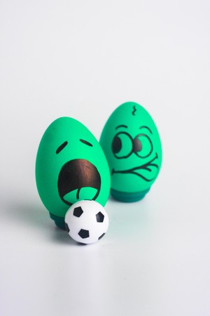 envy is green in football. football draw. victory and defeat in football. funny eggs and ball vertical leaf orientation