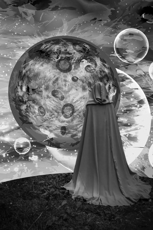 cosmos panorama. the lord of the worlds. illustration and photo combination. space starry space above worlds and planets and a man in a raincoat.