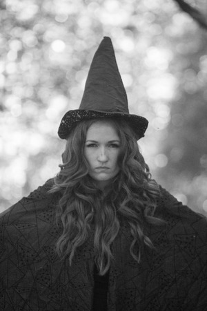 The witch is a laconic portrait. attractive girl in a cap monochrome Stock Photo
