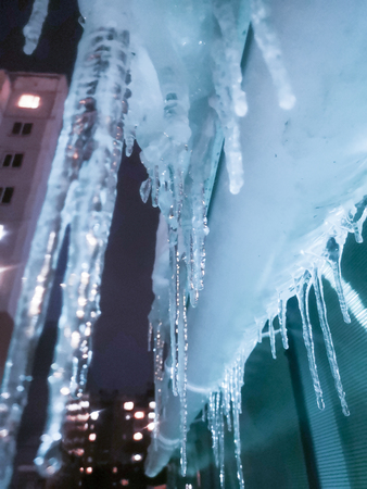 icicles are beautiful winter long. hang from the roof of houses. photo for your design