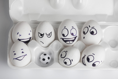 football team. eggs with funny faces. eggs and ball. photo for your design