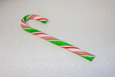 Candy cane striped. New Years caramel. white green red on white. photo for your design