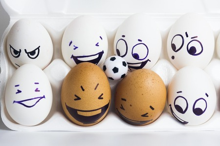 the fans. eggs with funny faces. eggs and ball. photo for your design
